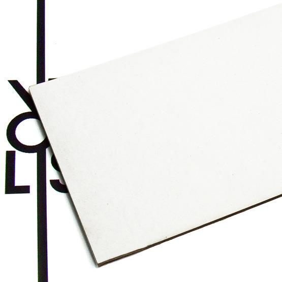 Superficie - cartone microonda bianco per il taglio laser