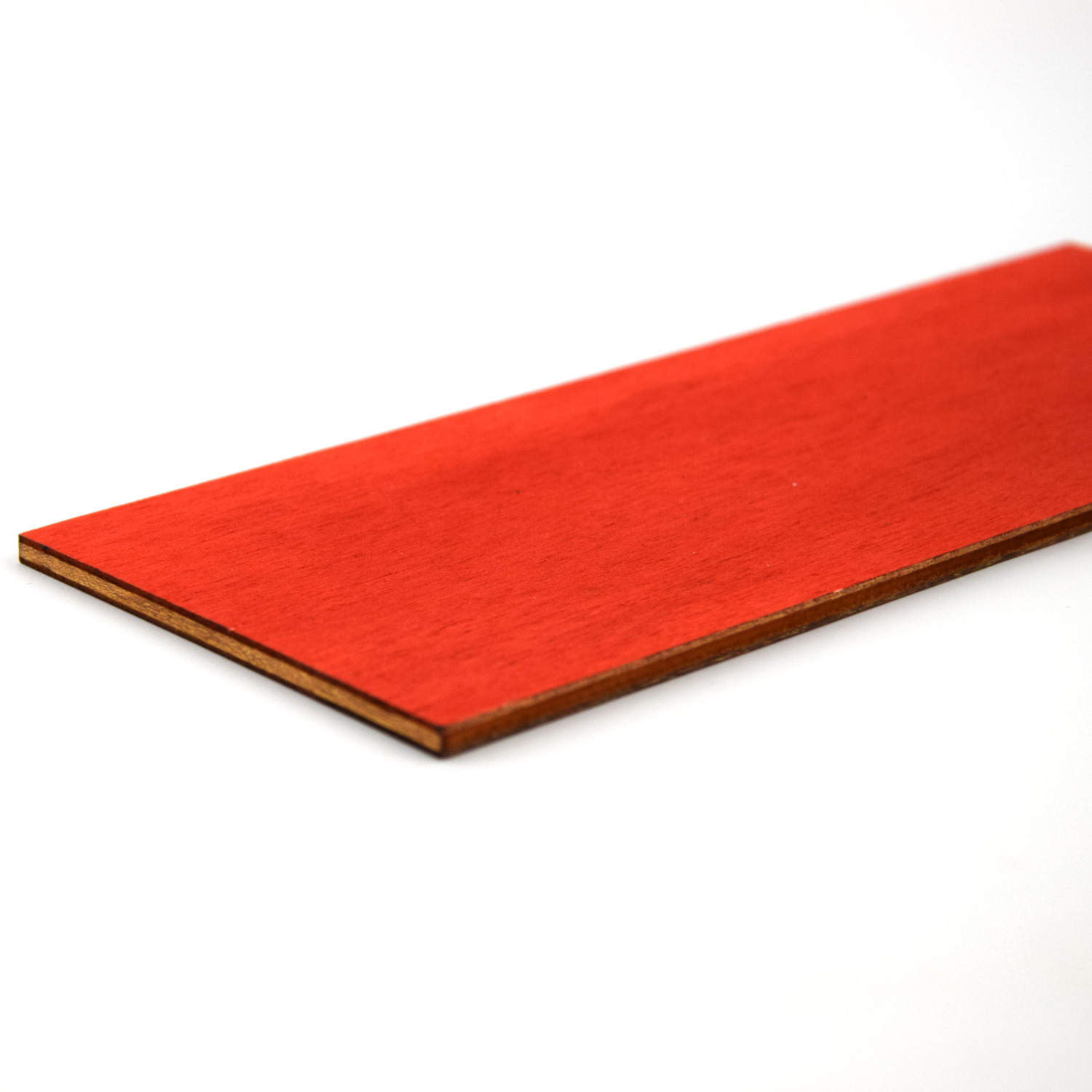 Laser cut edges of red painted poplar plywood