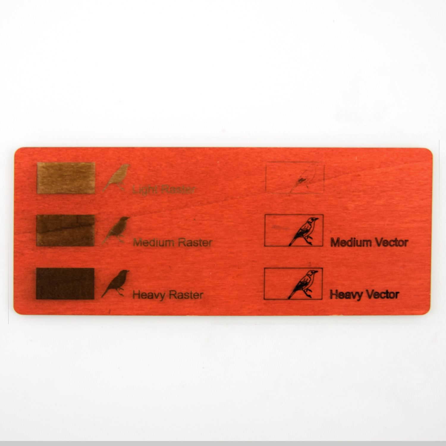 Examples of laser engraving on plywood of red painted poplar
