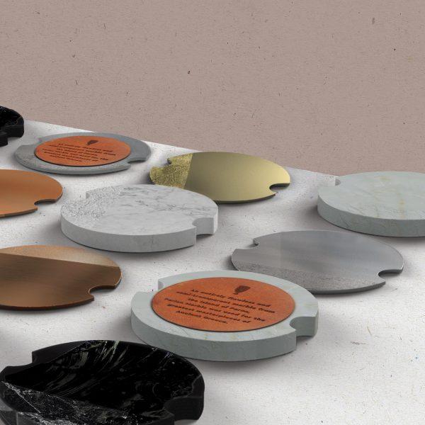 Theto - lasercut coasters in metal, acrylic and leather