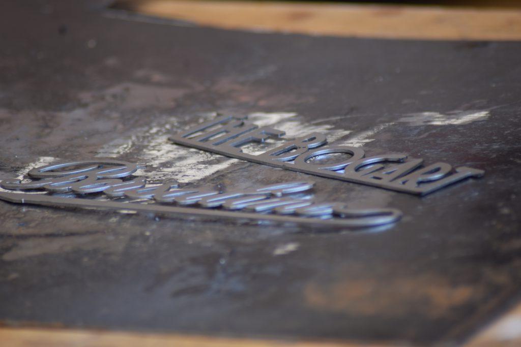 Borsalino exhibitor detail in laser-cut iron