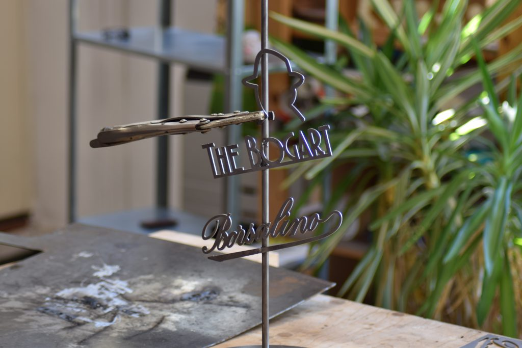 The Bogart Borsalino - iron display rack